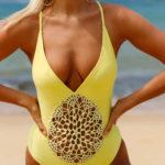 Žluté jednodílné plavky s děrovanou vsadkou
